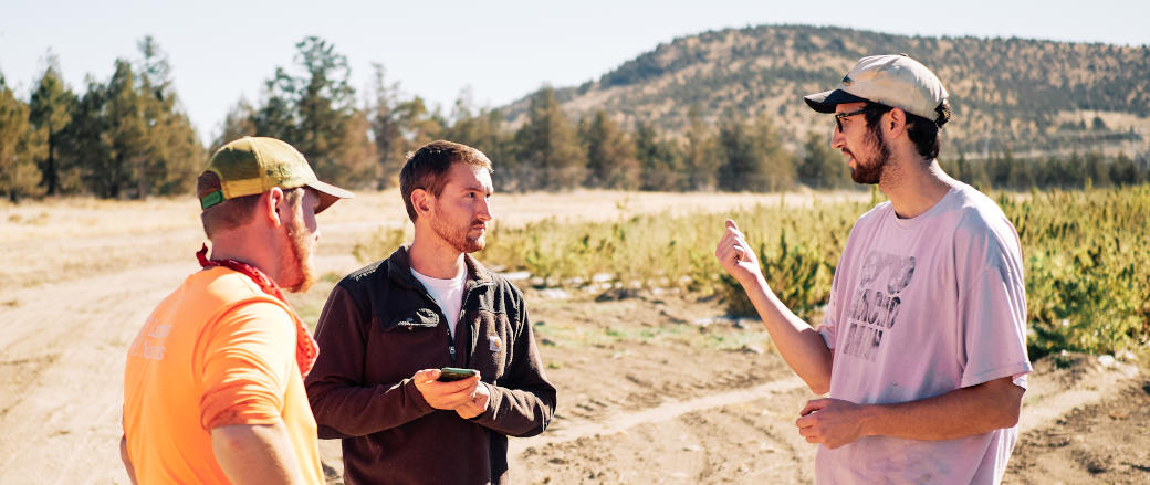 Photo of Lazarus Naturals CEO & Founder Sequoia Price-Lazarus talking to employees on the farm